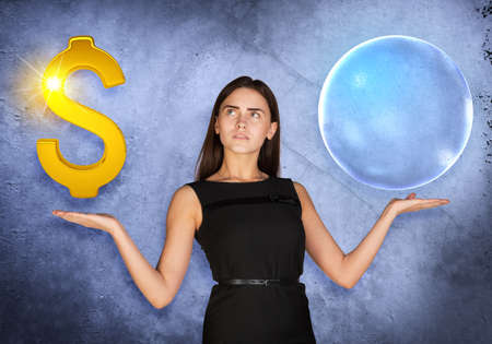busineswoman: Busineswoman holding dollar sign and big bubble on grey background