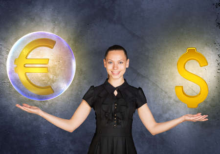 busineswoman: Busineswoman holding euro sign in big bubble and dollar sign on grey background Stock Photo