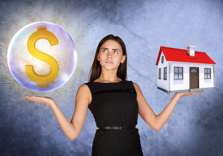 busineswoman: Busineswoman holding dollar sign in big bubble and house on grey background Stock Photo