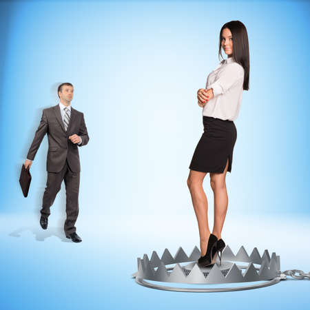 bear trap: Businessman with lady in bear trap on blue background Stock Photo