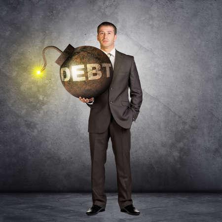 wick: Businessman with big debt bomb with lighting wick