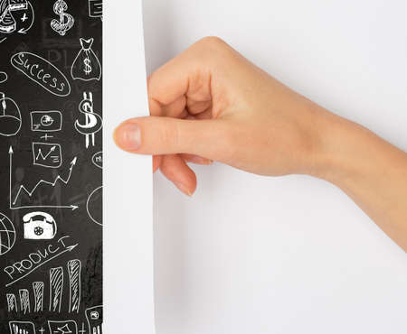 turning page: Hand turning blank page with black board and pictures