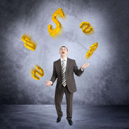 juggling: Businessman juggling dollar sign on abstract grey background