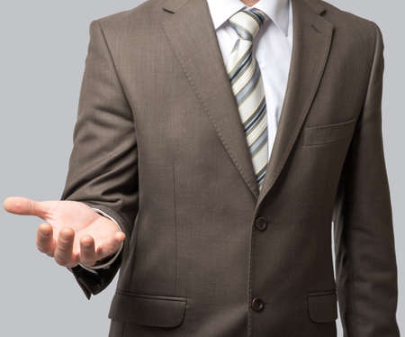Businessman with tie and outstretched empty hand, close up view
