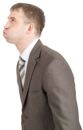 inflated: Businessman with inflated cheeks isolated on white background, side view