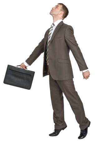 black briefcase: Businessman with black briefcase looking up isolated on white background