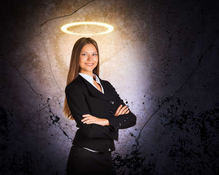 businesslady: Businesslady with nimbus looking at camera on grey background