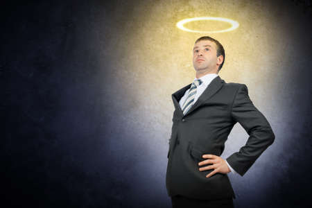 nimbus: Businessman with nimbus and looking up on grey background Stock Photo
