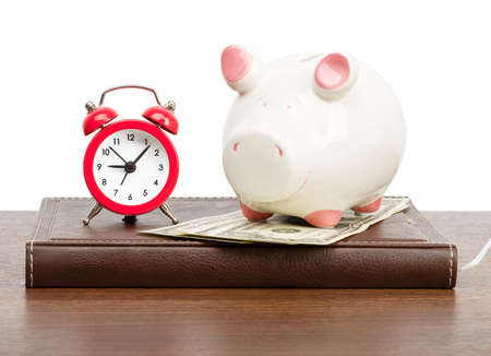 dayplanner: Alarm clock with piggy bank on personal organizer Stock Photo