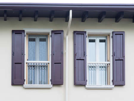 open windows: Two open windows with shutters in house