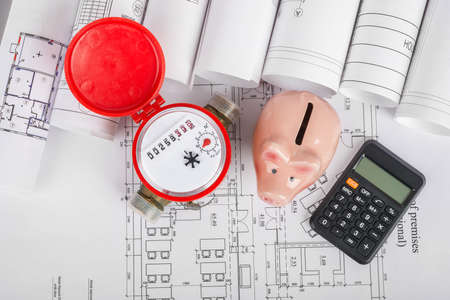 building blueprint: Water meter with calculator and piggy bank on blueprint background