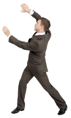 invisible: Businessman holding invisible thing isolated on white background, rear view Stock Photo