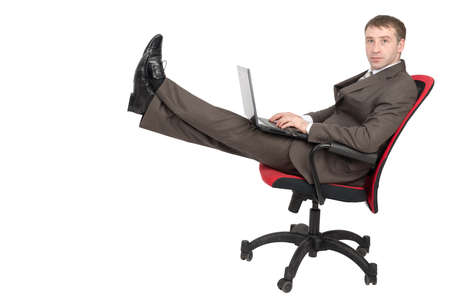 legs up: Businessman sitting on chair with laptop and legs up isolated on white background