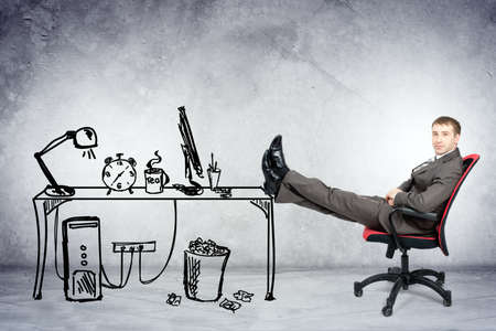 legs up: Businessman sitting on chair with legs up and looking at camera with drawn office Stock Photo