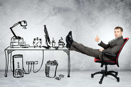 legs up: Businessman sitting on chair with legs up and looking at camera in drawn office