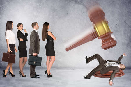inscribed: Inscribed gavel hitting scared businessman and crowd of waiting people, justice concept