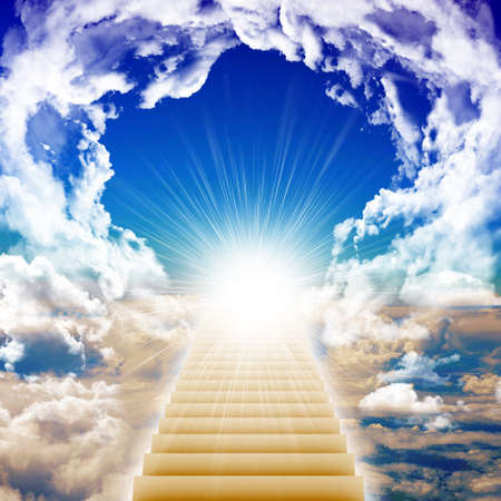 Stairway leading up to bright light with clouds, heaven concept