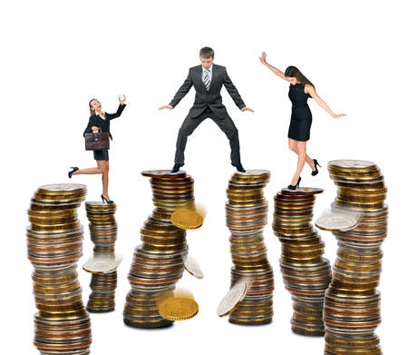 womna: Business people standing on coins isolated on white background