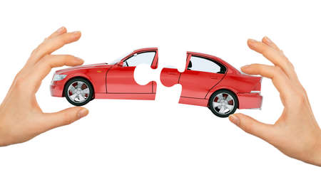 womans: Womans hand making car puzzle isolated on white background