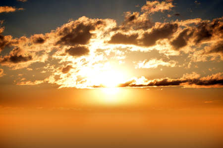 heaven: Sunset sky with sun and clouds, nature concept Stock Photo