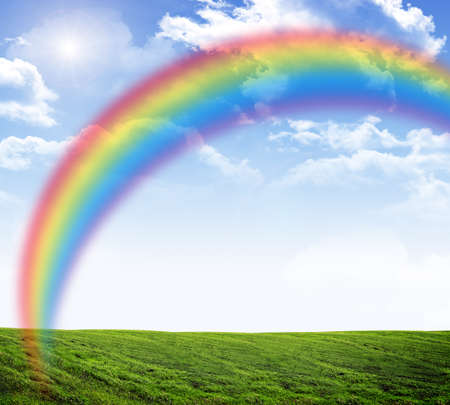 heaven: Blue sky with rainbow and green grass, nature concept