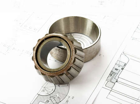 blue prints: Roller bearing on blue prints, side view Stock Photo