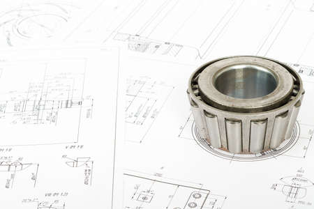 blue prints: Roller bearing on blue prints, close up view