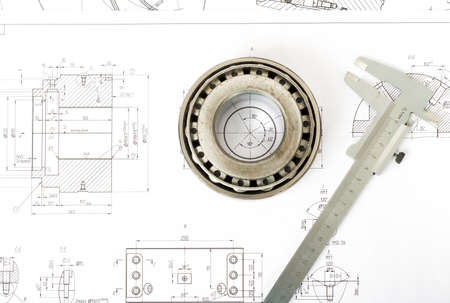 bearing: Roller bearing on blue prints with tool, top view