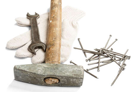 hardware repair: Hammer with nails and gloves isolated on white background