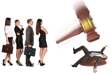 inscribed: Inscribed gavel hitting scared businessman and crowd of waiting people, isolated on white background. Justice concept