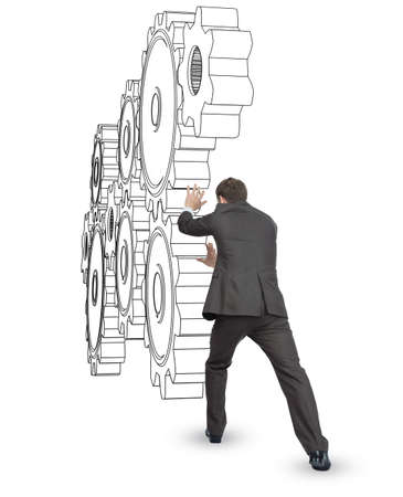 cog wheels: Businessman pushing cog wheels isolated on white background