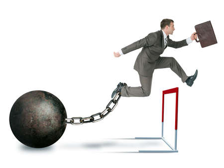 Businessman with iron ball hoppig over barrier isolated on white background, competition concept Stock Photo