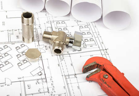 turn the screw: Architecture plan and rolls of blueprints with mixet tap. Building concept