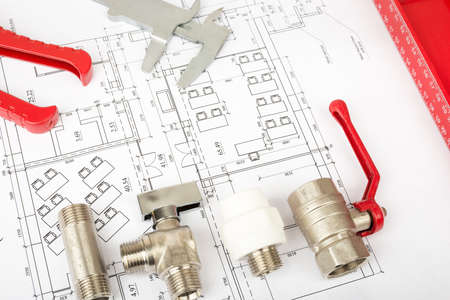 turn the screw: Architecture plan with red ruler and mixer tap. Building concept