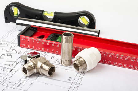 turn the screw: Architecture plan with level and tools. Building concept Stock Photo