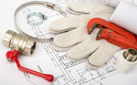 turn the screw: Architecture plan with gloves and turn-screws. Building concept Stock Photo