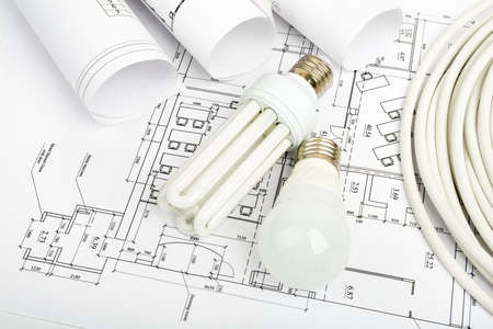 cabel: Architecture plan and rolls of blueprints with bulbs. Building concept Stock Photo