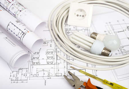 cabel: Architecture plan and rolls of blueprints with socket. Building concept Stock Photo