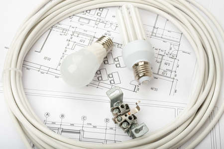 cabel: Architecture plan and rolls of blueprints with light bulbs. Building concept