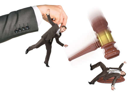 inscribed: Inscribed gavel hitting scared businessman isolated on white background. Justice concept Stock Photo