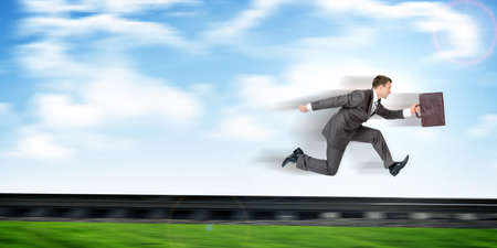 railtrack: Businessman with suitcase running away on rail-track