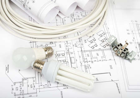 cabel: Architecture plan and rolls of blueprints with cabel and bulbs. Building concept Stock Photo