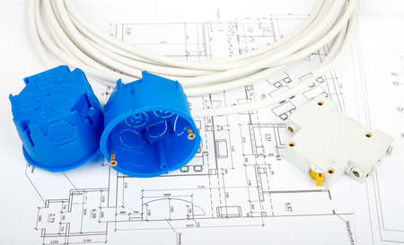Architecture plan and rolls of blueprints with cabel and blue plastic covers. Building concept