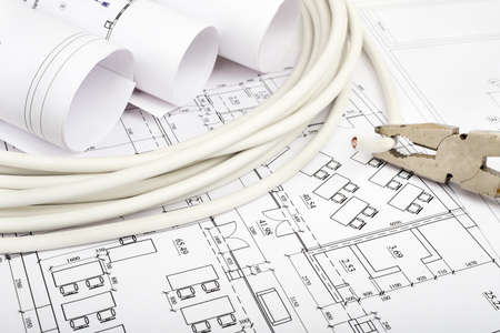 cabel: Architecture plan and rolls of blueprints with cabel and pliers. Building concept Stock Photo
