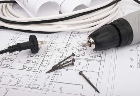 cabel: Architecture plan and rolls of blueprints with cabel and electric screwdriver. Building concept