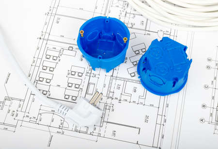 cabel: Architecture plan and rolls of blueprints with plug and blue plastic covers. Building concept