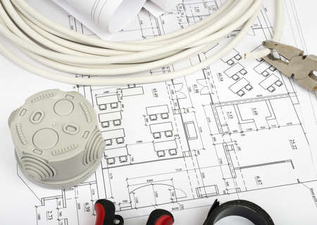 cabel: Architecture plan and rolls of blueprints with pliers and grey plastic cover. Building concept