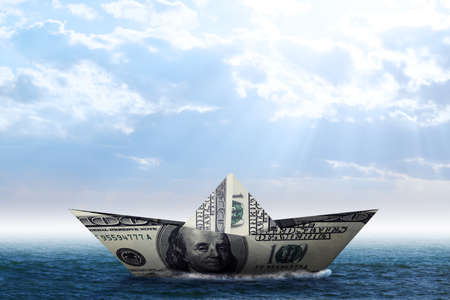 3d boat: Dollar paper boat in blue sea and blue sky. 3D rendering Stock Photo