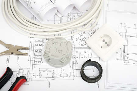 cabel: Architecture plan and rolls of blueprints with cabel and plug. Building concept