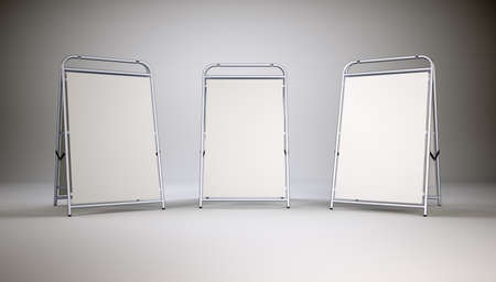 ad board: Three small empty stands on grey wall background. 3D illustration Stock Photo